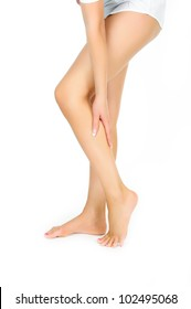 tired female legs being massaged with hand isolated on white background
