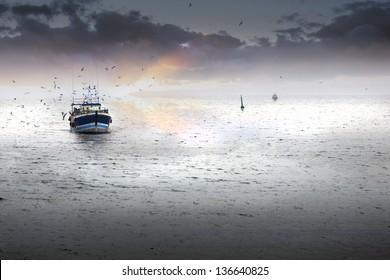 Tired fishing fleet getting back, France near the Atlantic ocean
