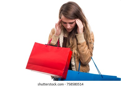 Tired girl with headache after doing shopping all day long isolated on white