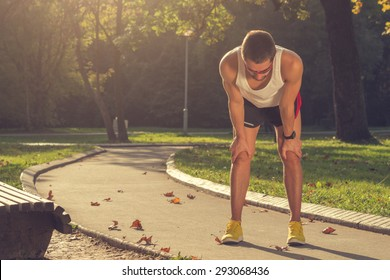 Tired jogger in the park.