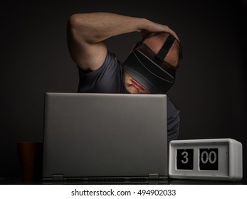 Tired man addict to technology and virtual reality with insomnia. Technology addiction and mental disorders concept.