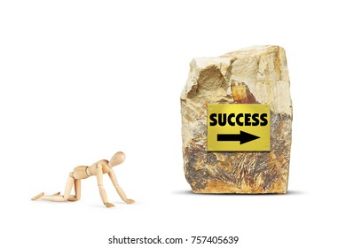 Tired man creeps towards success. Abstract image with a wooden puppet