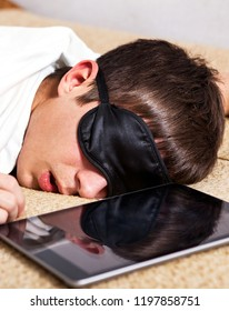 Tired Man sleep on the Sofa with Tablet Computer closeup