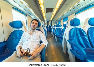 tired man sleeping on the train