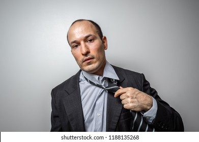 Tired man with suit isolated on white background