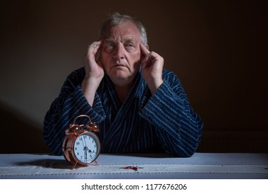 Tired mature man awake in the middle of the night