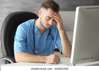 Tired medical assistant in his office