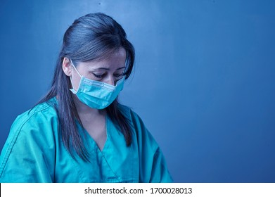 tired medical nurse after taking a large number of patients due to the epidemic of virus