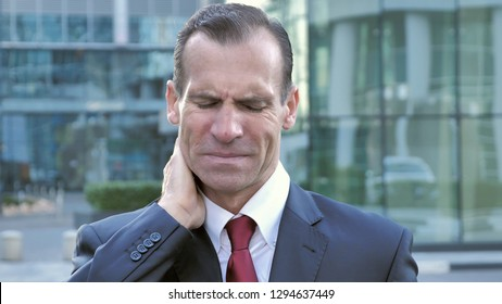 Tired Middle Aged Businessman with Neck Pain