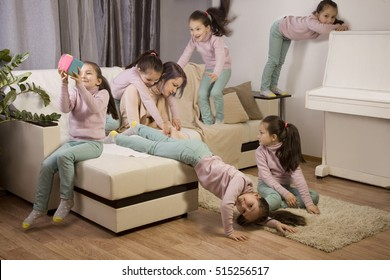 tired mother and a lot of kids. girl jumping on the couch, playing, furious, spoiled