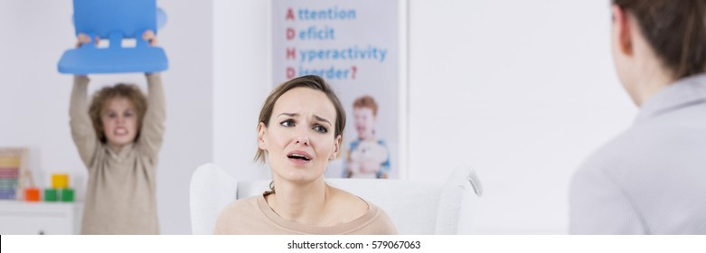 Tired mum and her son with ADHD meeting a psychologist
