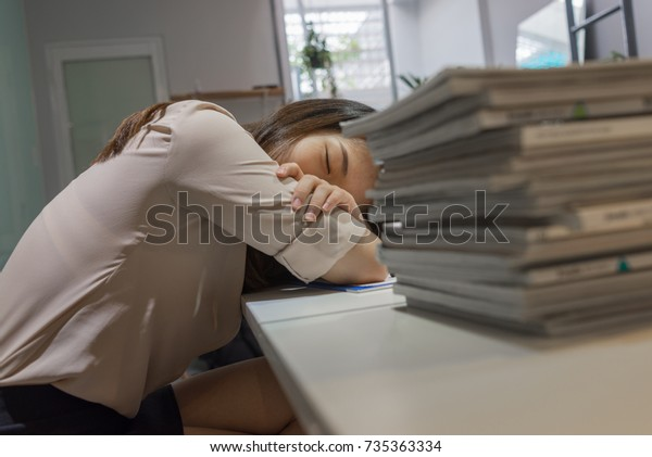 Tired office lady take a nap in break time