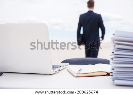 Tired of office life. Rear view of man in formalwear walking away from his working place