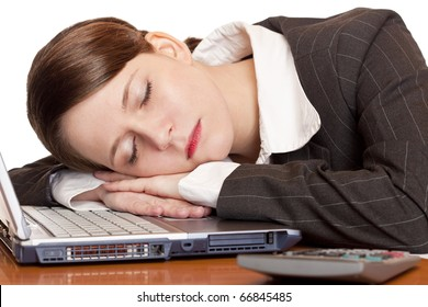Tired overworked business woman sleeps in office on laptop. Isolated on white background.