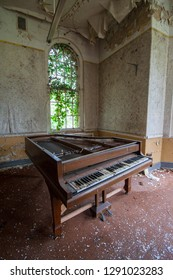 Tired piano at an abandoned and derelict lunatic asylum/hospital (now demolished), Cane Hill, Coulsdon, Surrey, England, UK