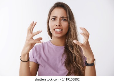 Tired pissed woman retelling bad bothering story describing how wanna choke stupid guy stepped new shoes, clenching raised hands angry, hateful grimacing annoyed, furious, releasing pressure
