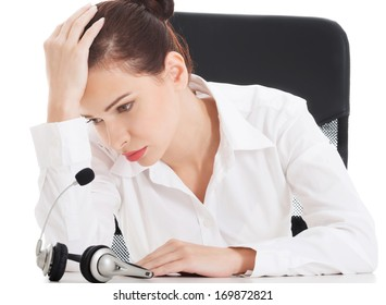Tired, sad business woman at call center. Over white background.