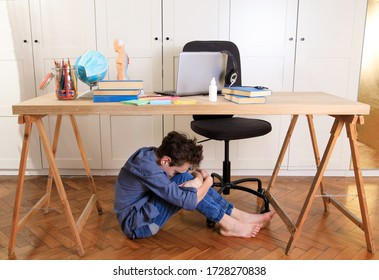 Tired sad frustrated boy sitting at the table with many books. Learning difficulties, school, education, online learning at home concept