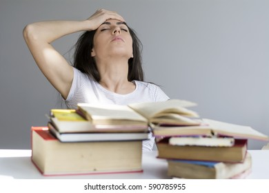 tired and sad  student  woman with books worried about exams