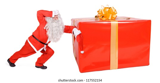 Tired Santa Claus is pushing a huge Christmas gift. Big Xmas Surprise. Gift package from Santa Claus, isolated on white background.