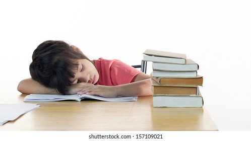 Tired schoolgirl sleeps at the desk, close up