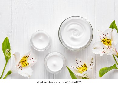 Tired skin cosmetic cream facial skincare medical relaxation therapy anti aging hydrate dermatology professional cleanser moisturizer natural hygiene product with flowers on white table background