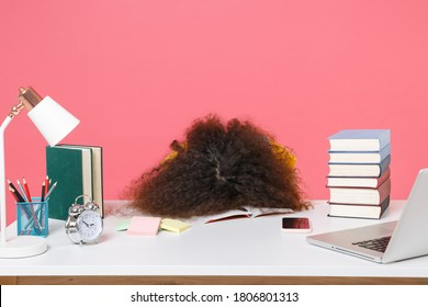 Tired sleeping african american woman employee in office sit work at desk put head on table isolated on pink background. Achievement business career. Education in school university college concept.