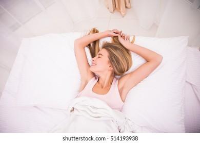 Tired sleepy woman waking up.