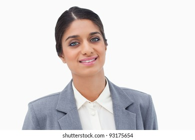 Tired smiling businesswoman against a white background