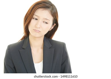 Tired and stressed Asian business woman.
