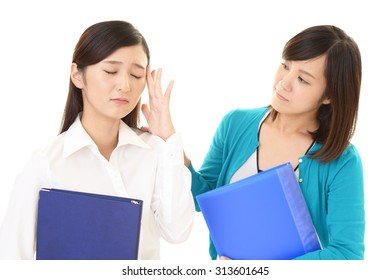 Tired and stressed Asian business women
