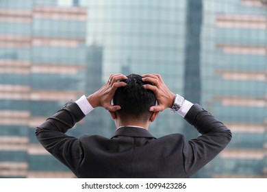 Tired or stressed businessman