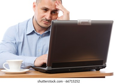 Tired and stressed young businessman working at his computer