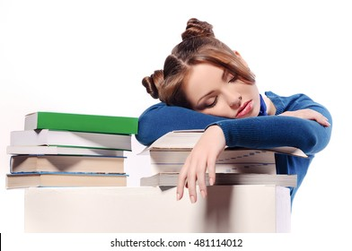 tired student fell asleep on textbooks, isolated