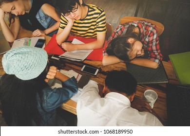 Tired of studying : Young people stop to sleep, relax during lunch break after tired of reading. Selective Focus