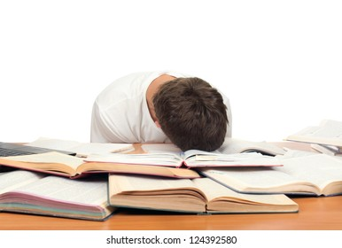 Tired Teenager lying and sleeping on the School Desk. Isolated On the White Background