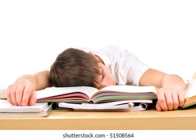 tired teenager lying and sleeping on the books
