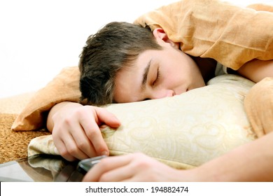 Tired Teenager sleeping on the Bed at the Home