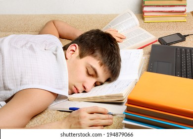 Tired Teenager sleeping on the Books at the Home