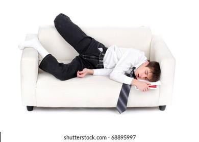 tired teenager sleeping on the sofa