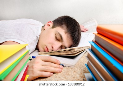 Tired Teenager sleeps after Learning on the Sofa with the Books