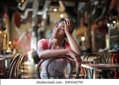 Tired waitress sitting