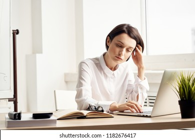 tired woman behind laptop