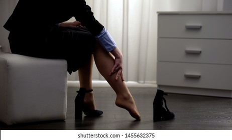 Tired woman feeling pain in leg, taking off shoes, inflammation of joint, heels