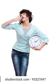 tired woman holding clock and yawning. isolated on white background