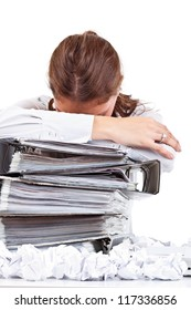 Tired woman with ringbinders sitting at the desk