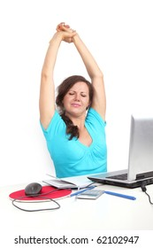 Tired woman sitting in office, stretching