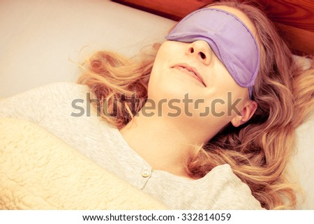 039fbe04fd1 Tired woman sleeping in bed wearing blindfold sleep mask. Young girl taking  nap. Instagram filtered. - Image