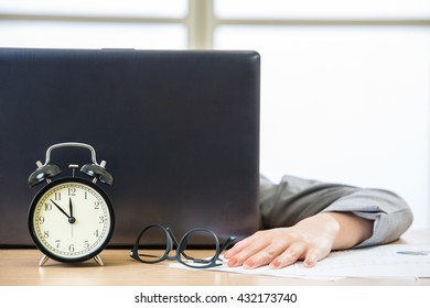Tired woman are sleeping at desk in the office