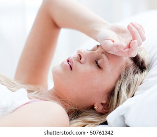 Tired woman sleeping on a bed at home